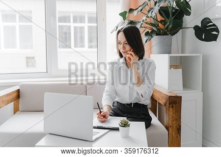 Young Business-woman Talking On The Phone At Home Or Office. Business, Freelance Concept.