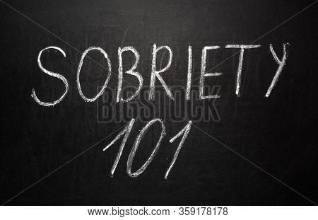 Sobriety 101 Written In White Chalk On A Black Chalkboard.