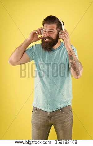 Freedom Going Wireless Offers You Is Unparalleled. Hipster Happy Using Modern Wireless Headphones. W