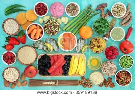 Health food for a healthy diet with immune boosting foods & herbs high in antioxidants, anthocyanins, vitamins, minerals, protein, smart carbs, omega 3 & dietary fiber. Flat lay,  top view.