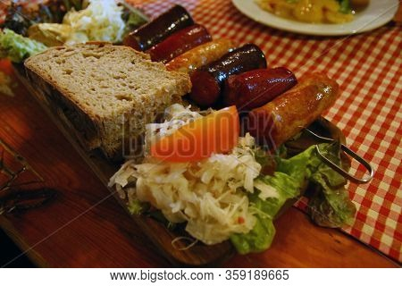 Bread And Wurst At Typical Restaurant In Wien