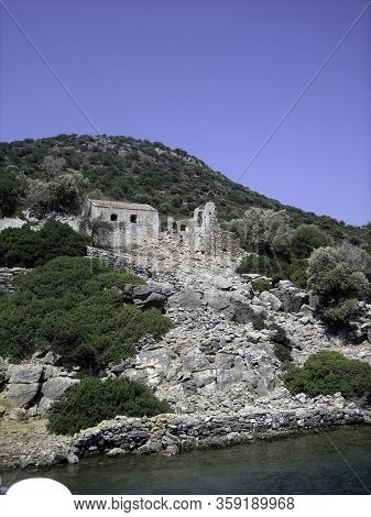 Mountainous Sea Coast With Architectural Monuments Of Antiquity, View From The Water.