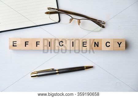 Modern Business Buzzword - Efficiency. Top View On Wooden Table With Blocks. Top View. Close Up.
