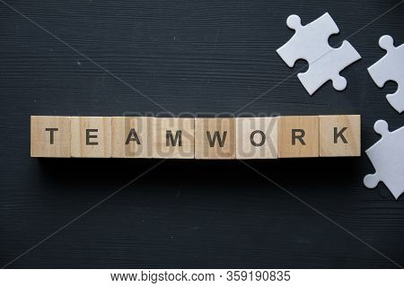 Modern Business Buzzword - Teamwork. Top View On Wooden Table With Blocks. Top View. Close Up.