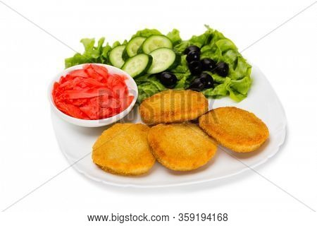Fried fish cutlet with vegetables. Isolated on white.