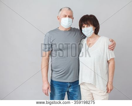 Couple of elderly people in medical masks. Mature man and woman in the period of the pandemic and quarantine coronavirus