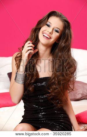 Portrait Of A Beautiful Brunette Teenager Spraying Perfume Bottle