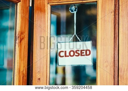 Text Closed Sign On Door Of Cafe. The Impact From The Epidemic Of Coronavirus (covid-19).