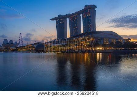 SINGAPORE CITY SINGAPORE: FEBRUARY 12 2020: Singapore Merlion Park downtown Singapore  business district at sunrise