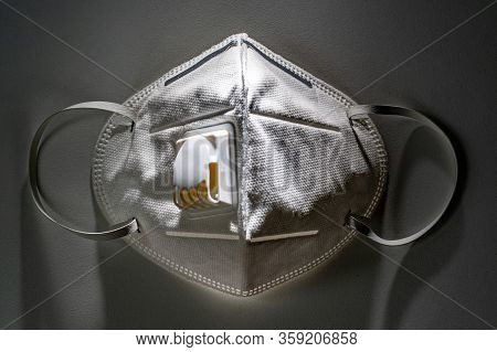 N95 Mask On White Table With Dramatic Contrasty Lighting, Health Concept