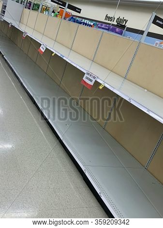 Dayton, Oh- Mar 25, 2020: Bare Shelves For Toilet Paper At Meijer Grocery Store. Not A Single Role O