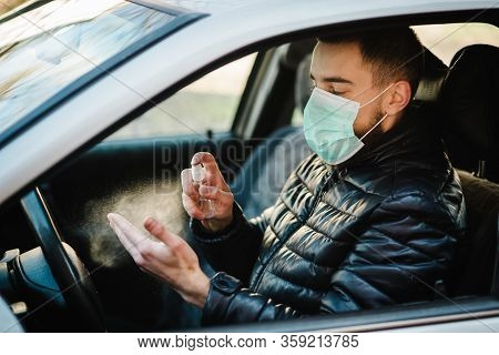 Spraying Anti-bacterial Sanitizer Spray On Hand In Car, Infection Control Concept. Sanitizer To Prev