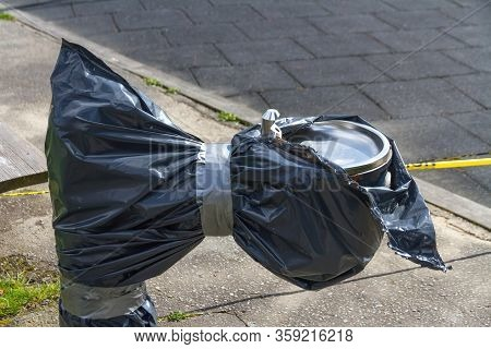 A Water Fountain Is Wrapped In Heavy Plastic During Covid-19