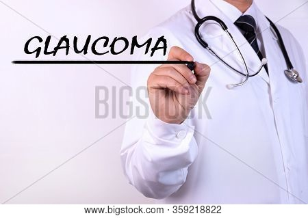 Doctor Writing Word Glaucoma With Marker Medical Concept