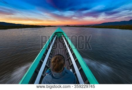 Tourist In Myanmar - Young Woman Enjoys A Boat Ride On Inle Lake