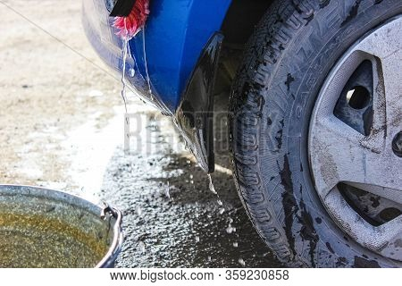 Chelyabinsk, Russia-april 3, 2020: Water Flowing From The Car On The Mudguard.