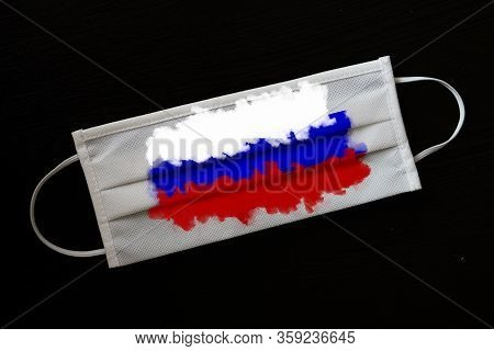 Medical Mask With The Image Of The Flag Of The Russia. Concept Of The Ncov-19 Coronavirus Pandemic.