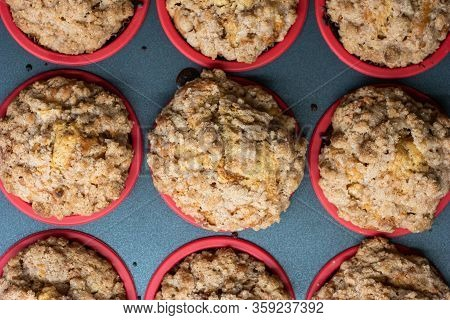 Homemade Apple Crumble Cupcake Muffins In Tray Close Up Top View Shot