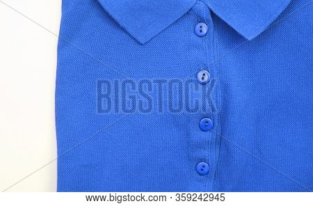 Blue Polo Shirt Close Up View. Casual Plain Polo T-shirt, Button-up Short Sleeve Unisex Clothing Det
