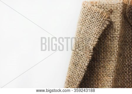 Hessian Burlap Cloth Detail Isolated On Empty White Background. Crumpled Sack Fabric Texture, Fragme