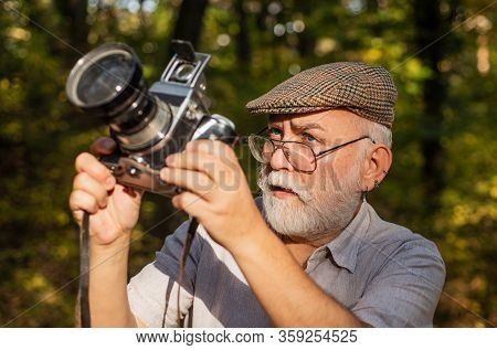 Pension Hobby. Experienced Photographer. Vintage Camera. Old Man Shoot Nature. Professional Photogra