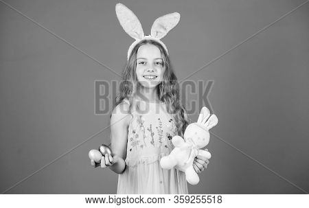 Happy Easter. Happy Little Girl Wearing Easter Bunny Ears. Small Girl In Bunny Headband Holding Colo