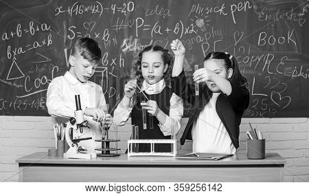 Boy And Girls Enjoy Chemical Experiment. Organic Chemistry Is Study Of Compounds Containing Carbon.