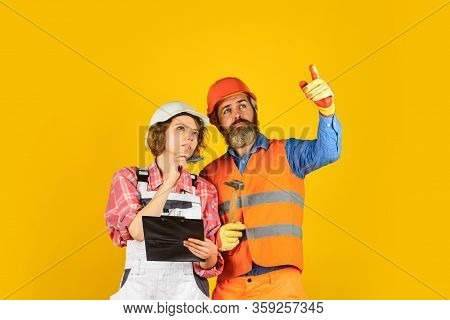 Family Counting Finances For Renovation. Redevelopment Of Home. Renovation Concept. Couple Planning
