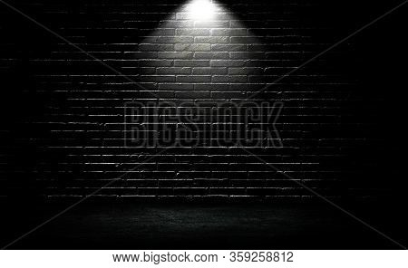 Empty Space Of Studio Dark Room Black Brick Wall And Spotlight With Concrete Floor For Showing Produ