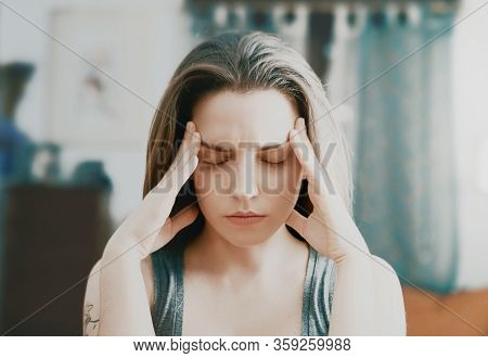 Beauty, Young Woman With Headache At Home