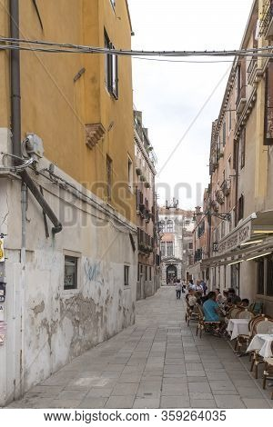 Venice, Italy - June 30, 2017: A View Of The Small Streets Of Venice,the Colorful Venetian Houses Wi