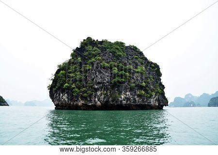 Round Islet Emerged From Sea In Ha Long Bay