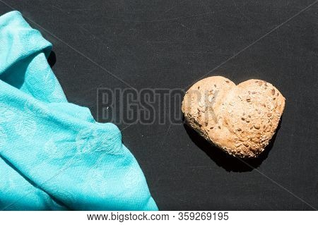 Heart Shape Of Wholemeal Bread On Blackboard Backround
