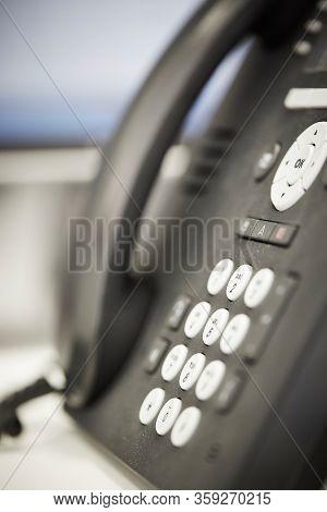 Close Up Of Landline Telephone On Office Desk