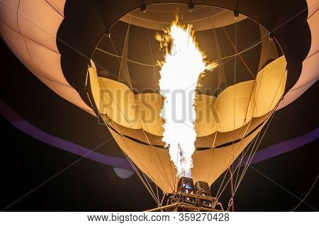 Preparation Of A Hot Air Balloon For Flight By Heating The Air With A Gas Burner On Evening In A Sum