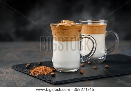 Two Glass Cups With Dalgona Frothy Coffee Trend Korean Drink Latte Espresso With Coffee Foam On Blac