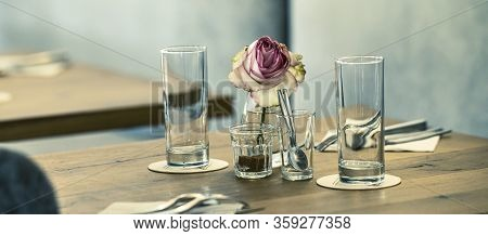 View Of Table With Flower In A Restaurant