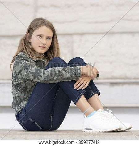 Horizontal Portrait Of Teenager Girl Outdoor, France, Europe