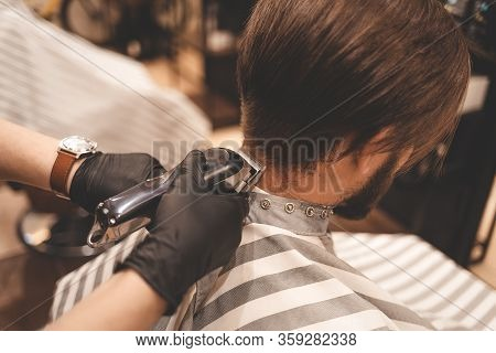 The Hairdresser Makes A Haircut With Clipper. Barber Doing Haircut Clipper