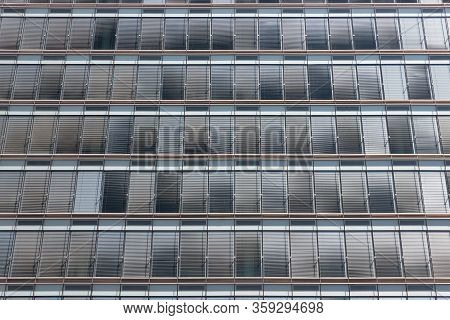 Symmetrically Background Of Grey Sunshades At Facade Modern Office Building