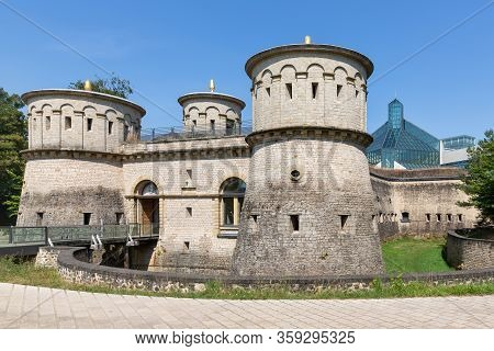Luxembourg City, Luxembourg- August 19, 2018: Walls And Towers Of Old Fortress Three Acorns In Luxem