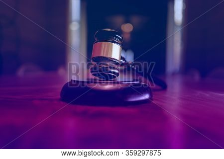 Legal law office business concept image, gavel in boardroom.