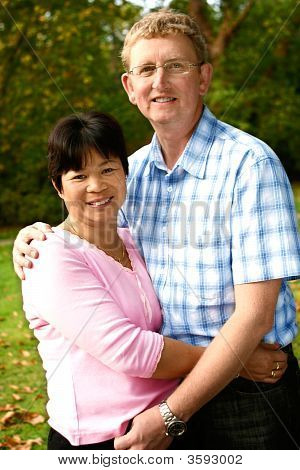 Loving Couple Of Inter Married  Thai And Caucasian Background