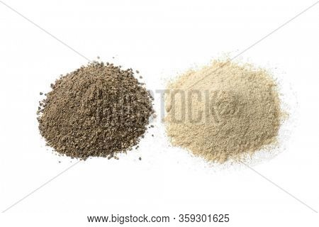 Heap of ground white and black pepper isolated on white background