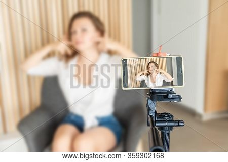 Vlog.tutorials.face Building. Young Female Blogger On Phone Screen Taking Selfie Picture Or Video Us
