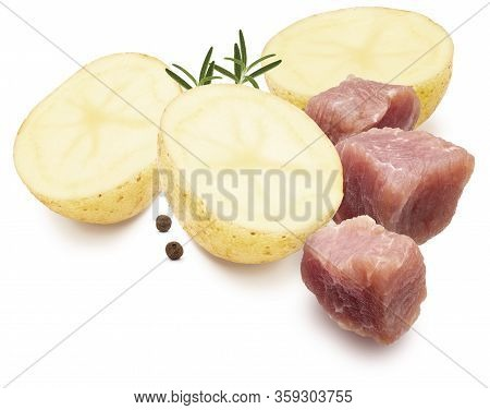Ingredients For Stew. Dices Of Meat, Potatoes, Black Pepper And Rosemary. Isolated On White Backgrou