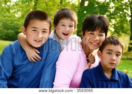 092 Thai Mom With Her Three Boys Enjoying The Autumn Park