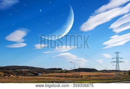 Moon In Bright Clouds Of Sunset Sun . New Moon , Moon In The Blue Sky New Moon In The Clouds