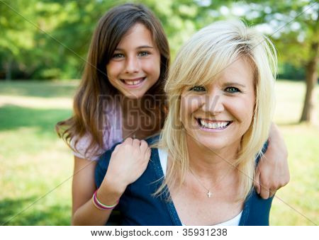 Mother And Young Daughter Outside