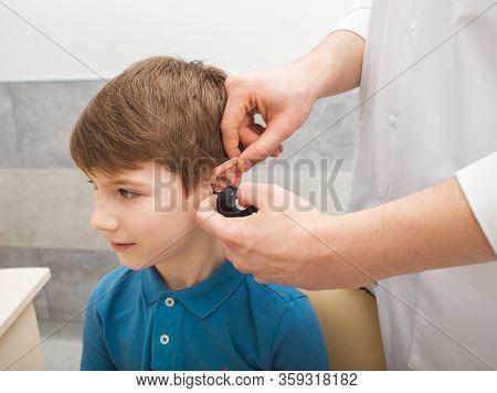 Otolaryngologist Doing A Hearing Exam In A Boy. Tympanometry Measures The Pressure In The Middle Ear